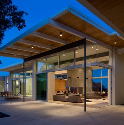 Modern Home In Texas Is Surrounded By Oak Trees