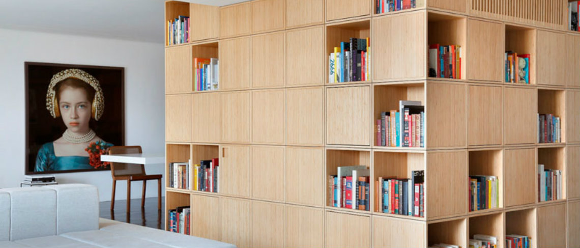 A Central Bookcase Hides The Entrance In This Modern Apartment